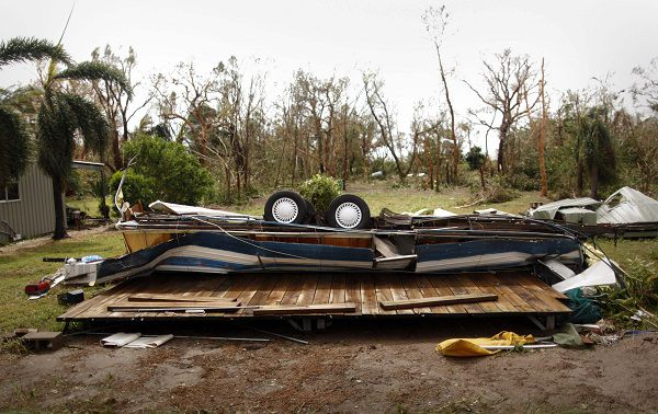 An overturned caravan lies flattened on the ground after Cyclone Yasi passed, in the northern Australian town of Cowley Beach February 3, 2011. One of the most powerful cyclones on record, Yasi tore off roofs, toppled power lines and terrified tens of thousands of people hunkered down in their homes in northeastern Australia on Thursday but there were no reports of deaths. REUTERS/Tim Wimborne (AUSTRALIA - Tags: DISASTER ENVIRONMENT IMAGES OF THE DAY)
