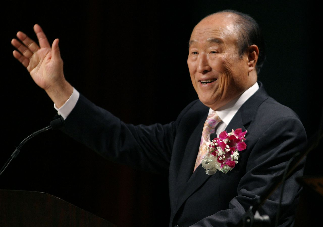"""FILE - In this Saturday, June 25, 2005 file photo, Unification Church leader Rev. Sun Myung Moon speaks during his """"Now is God's Time"""" rally in New York. Moon, self-proclaimed messiah who founded Unification Church, has died at age 92 church officials said Monday, Sept. 3, 2012. (AP Photo/John Marshall Mantel)"""