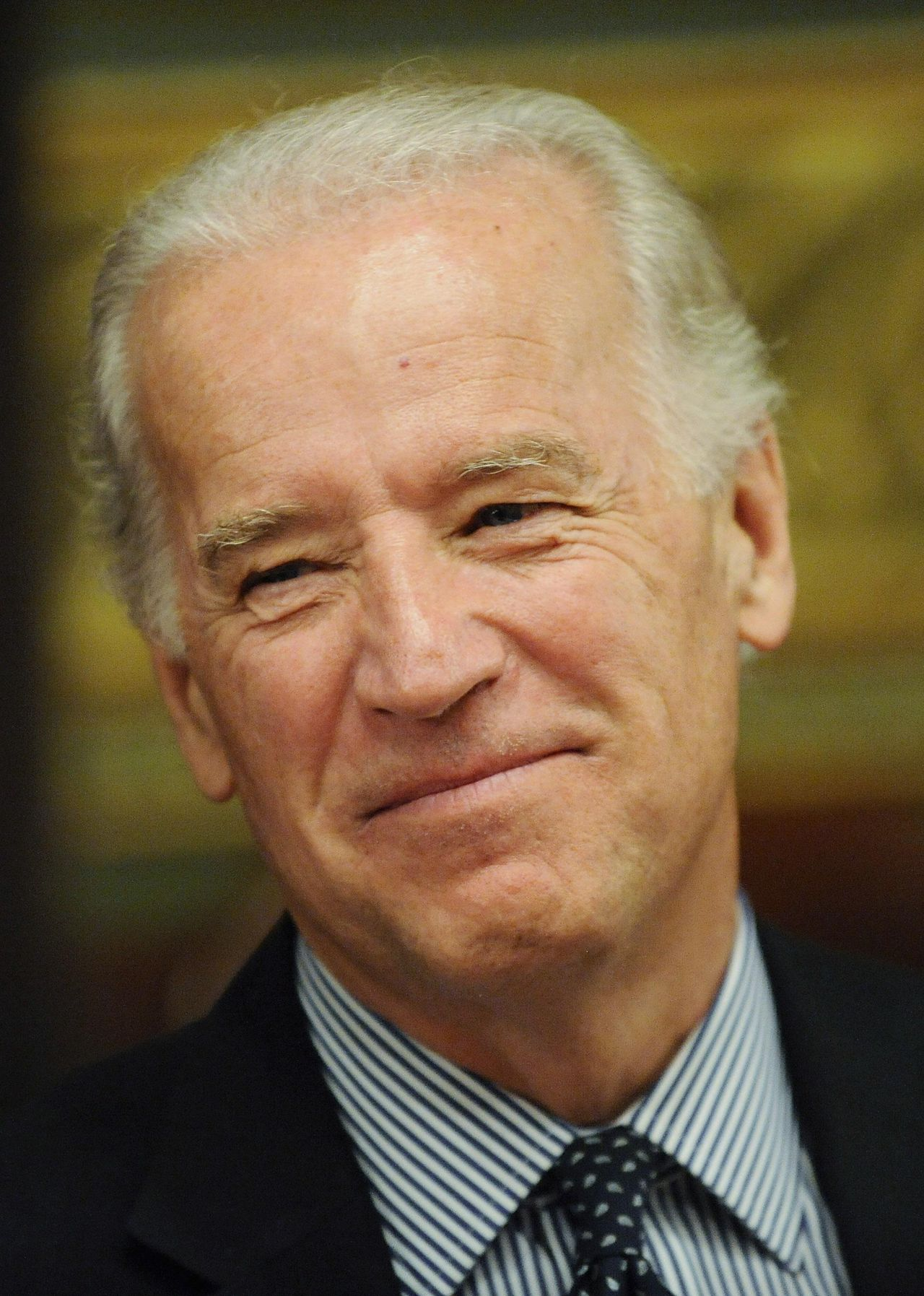 US Vice President Joe Biden smiles during a meeting of the Economic Recovery Implementation Cabinet in his ceremonial office in the Eisenhower Executive Office Building in Washington, May 6, 2009. REUTERS/Jonathan Ernst (UNITED STATES POLITICS BUSINESS)