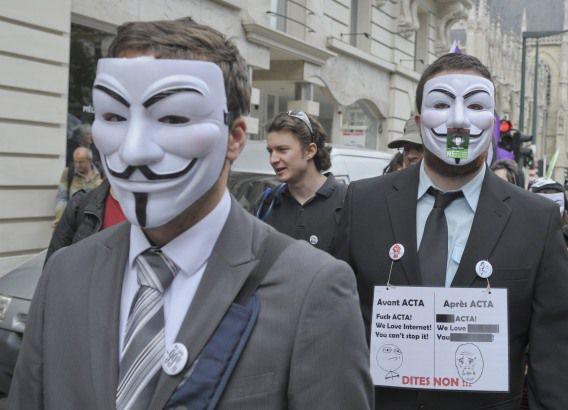 Demonstranten tijdens een protest tegen ACTA in Brussel, 9 juni 2012.
