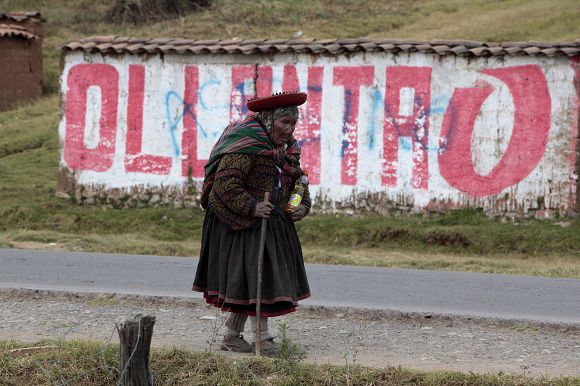 An Indigenous woman walks past a wall with electoral propaganda of the Peru's presidential candidate Ollanta Humala, of the Gana Peru party, in Cuzco, Peru, Saturday, June 4, 2011. Humala will face Keiko Fujimori, daughter of former Peru's President Alberto Fujimori, in a presidential runoff June 5. (AP Photo/Esteban Felix)
