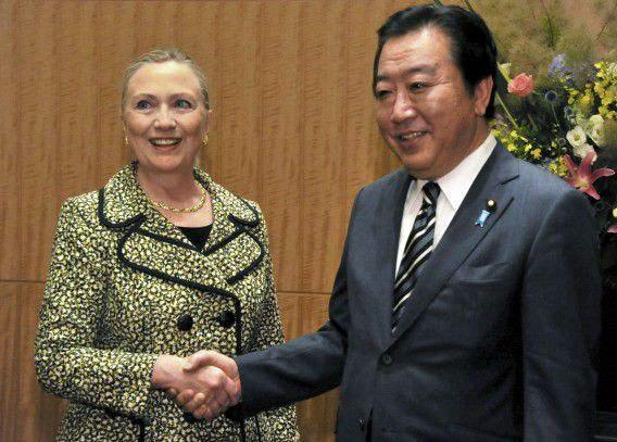 U.S. Secretary of State Hillary Clinton (L) shakes hands with Japan's Prime Minister Yoshihiko Noda at the Tokyo Conference on the Reconstruction of Afghanistan, in Tokyo July 8, 2012. REUTERS/Pool (JAPAN - Tags: POLITICS) JAPAN OUT. NO COMMERCIAL OR EDITORIAL SALES IN JAPAN