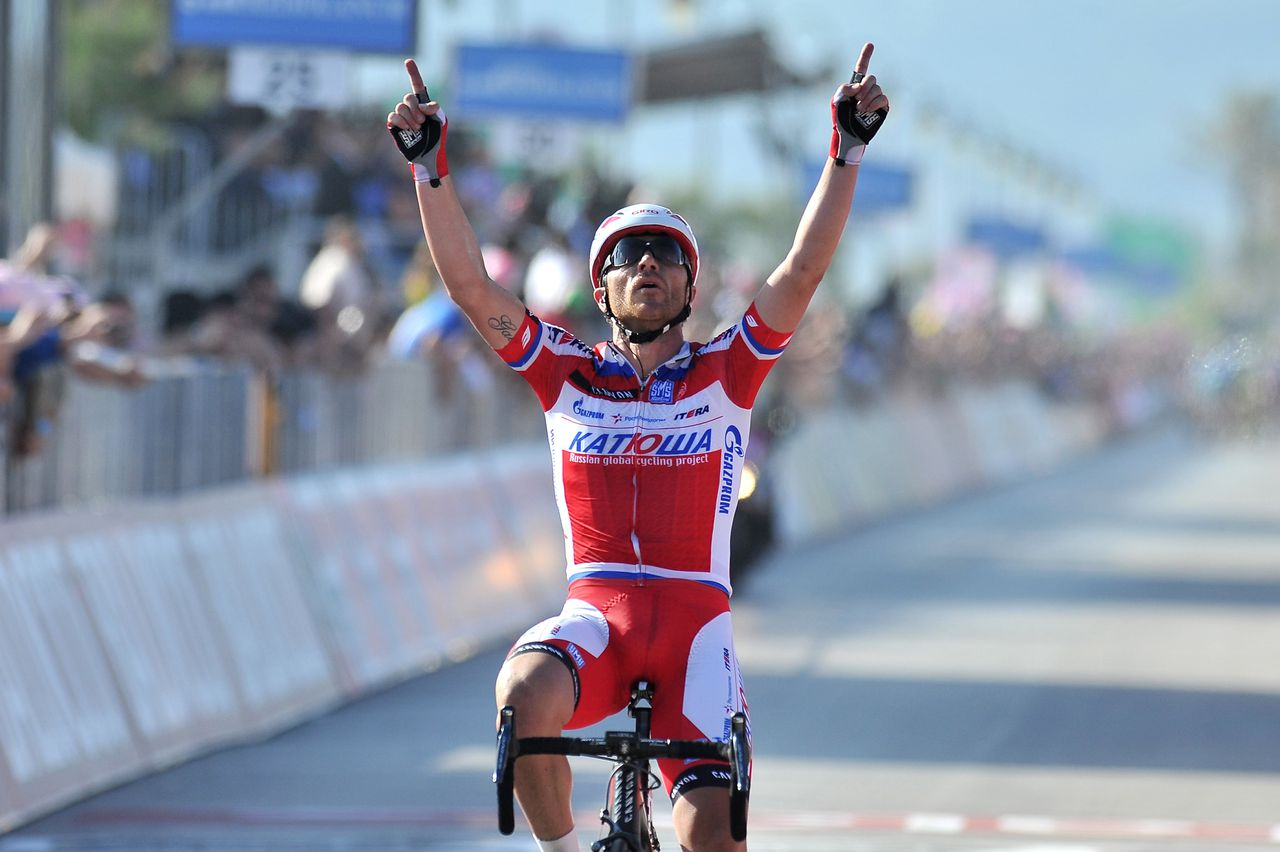 Italy's Luca Paolini crosses the finish line to win the third stage of the Giro d'Italia from Sorrento to Marina di Ascea, Italy, Monday, May 6, 2013, and gain the pink jersey of leader of the race. Paolini, who rides for Katusha, broke away toward the end of the final descent to complete the 222-kilometer (138-mile) leg from Sorrento to Marina di Ascea in 5 hours, 43 minutes, 50 seconds. (AP Photo/Gian Mattia D'Alberto)
