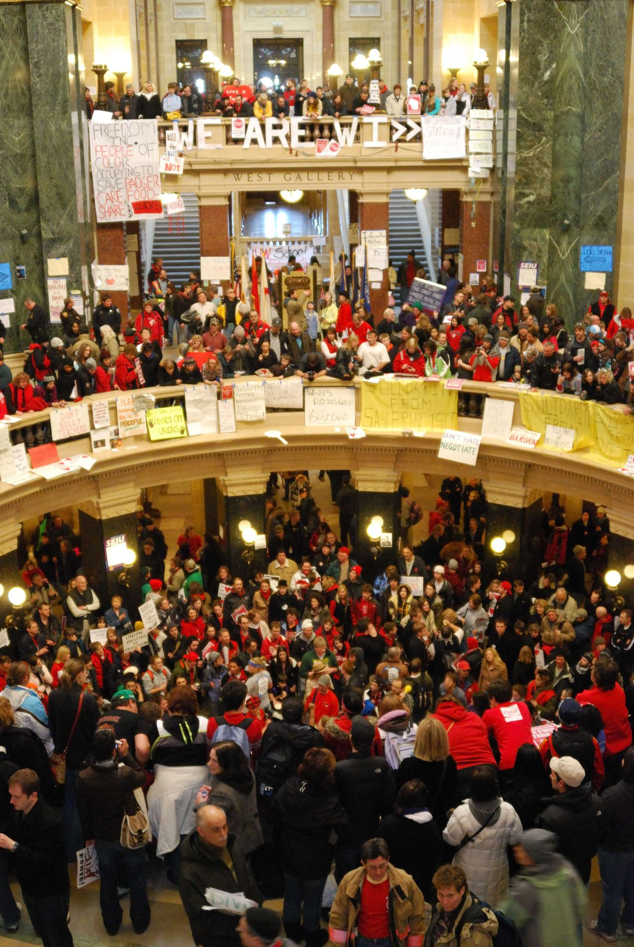 An estimated 65,000 protestors descended on Wisconsin's legislature on February 19,2011 in the fifth day of mass demonstrations against a Republican plan to bust public workers unions. Demonstrators who have camped out in capitol dome since Tuesday insisted that they will not give up the fight against what they see as a broad plan by Republicans to undermine working people and the Democratic Party they support. AFP PHOTO / Mira OBERMAN