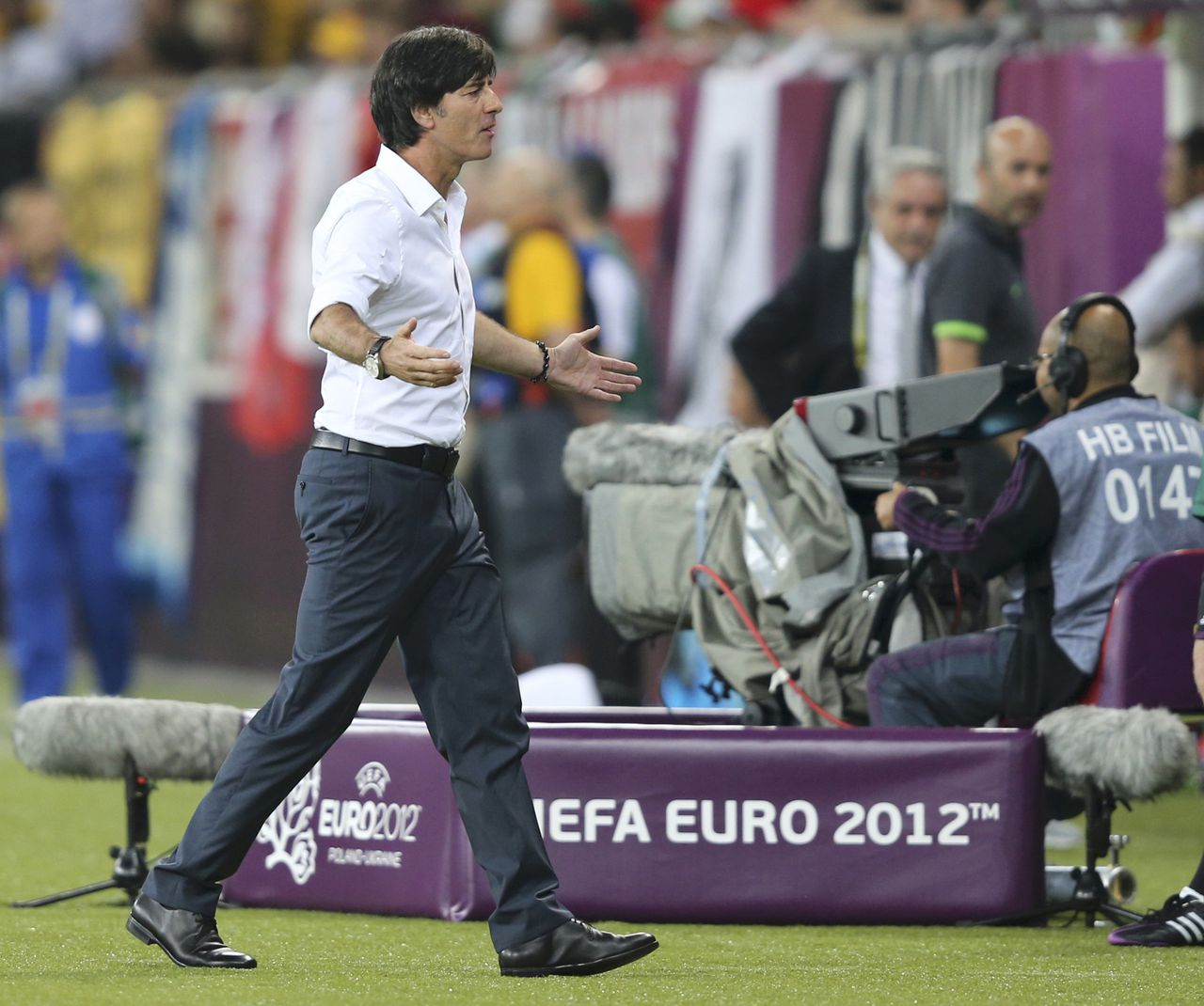 Germany's coach Joachim Loew reacts during their Group B Euro 2012 soccer match against Portugal at the new stadium in Lviv, June 9, 2012. REUTERS/Thomas Bohlen (UKRAINE - Tags: SPORT SOCCER)