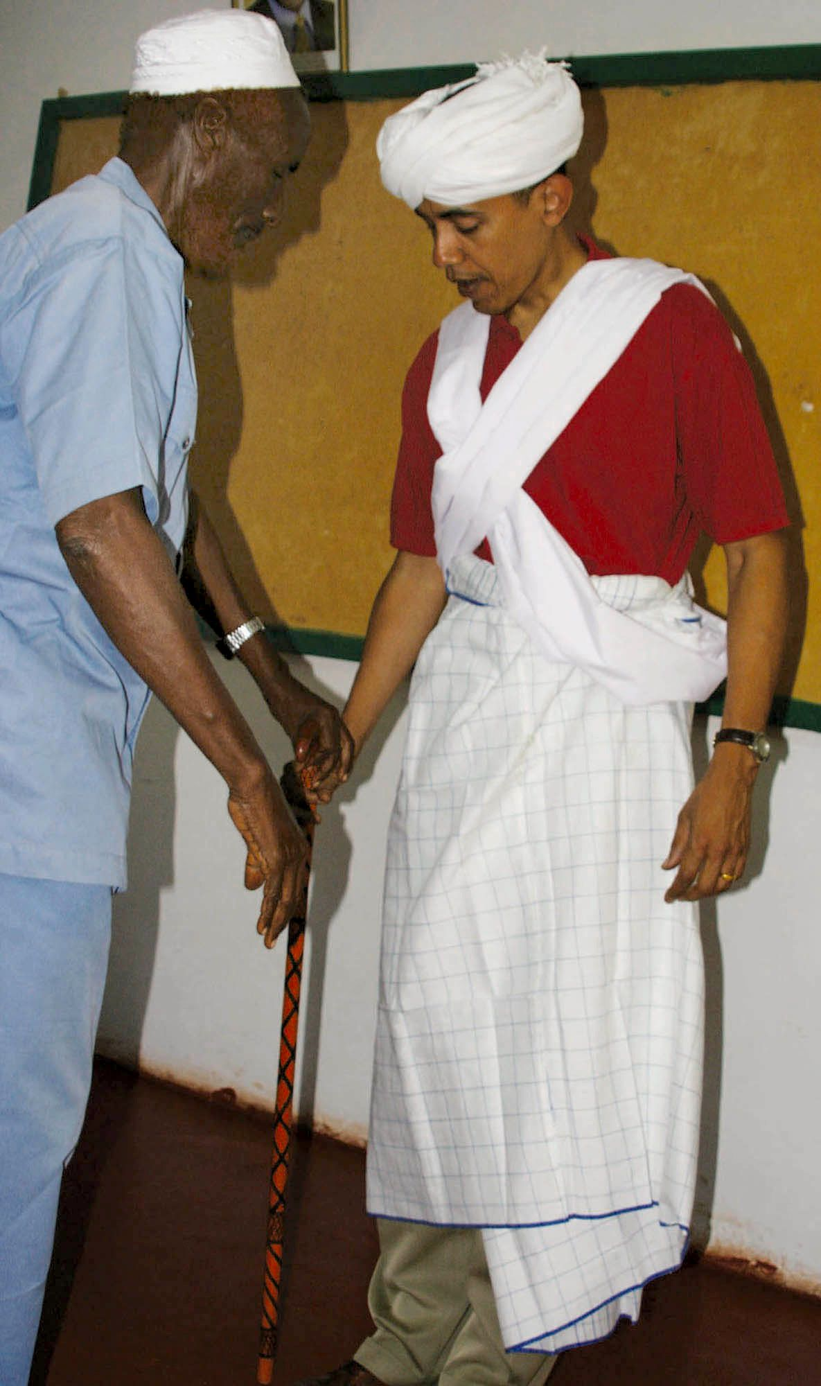 ** ADDING THE DATE OF THE PHOTOGRAPH - FILE ** Sen. Barack Obama, D-Ill., right, is dressed as a Somali Elder by Sheikh Mahmed Hassan, left, during his visit to Wajir, a rural area in northeastern Kenya, near the borders with Somalia and Ethiopia in this file photo from Aug. 27, 2006. The garb was presented to Obama by elders in Wajir. Obama's estranged late father was Kenyan and Obama visited the country in 2006, attracting thousands of well-wishers. (AP Photo)