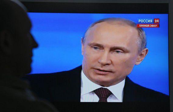 De Russische president Vladimir Poetin tijdens het vraaggesprek vandaag.
