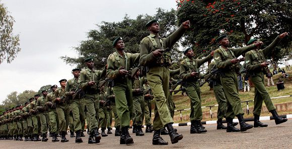 Caption: FILE - In this Tuesday, Aug. 24, 2010 file photo, Kenya Army soldiers rehearse a military parade at Uhuru Park, in Nairobi, Kenya. Kenyan military forces moved into southern Somalia on Sunday, an official and residents said, a day after top Kenyan defence officials said the country has the right to defend itself after a rash of militant kidnappings of Europeans inside Kenya. (AP Photo/Sayyid Azim, File)