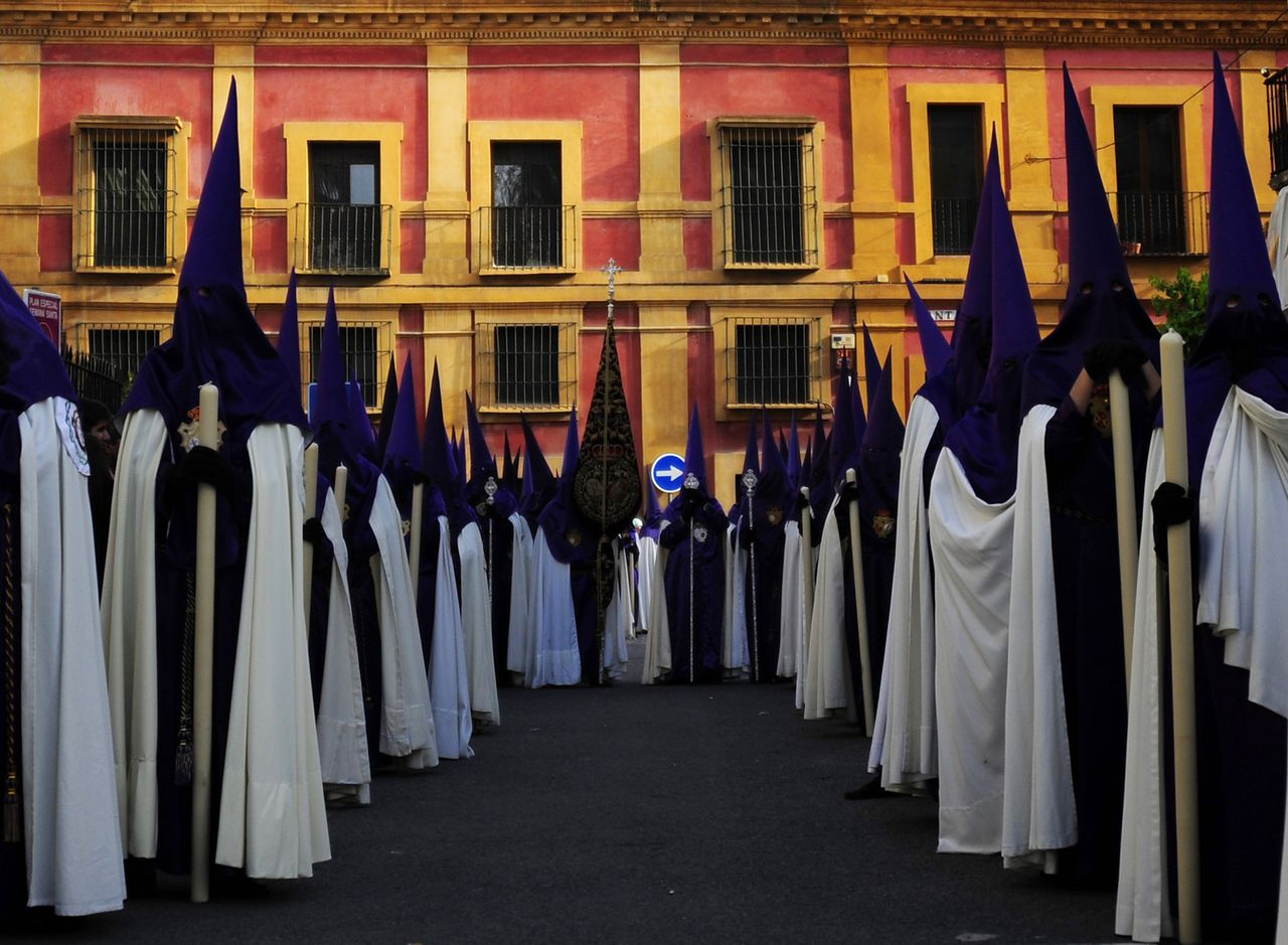 "Penitents of the ""Las Cigarreras"" brotherhood take part in a procession during the Holy Week in Sevilla on March 28, 2013. Christian believers around the world mark the Holy Week of Easter in celebration of the crucifixion and resurrection of Jesus Christ. AFP PHOTO/ CRISTINA QUICLER"