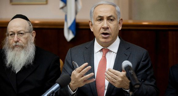 Caption: Israeli Prime Minister Benjamin Netanyahu, right, attends the weekly cabinet meeting in Jerusalem, Sunday, Aug. 28, 2011. Also seen in the picture is Yaakov Litzman, Deputy Minister of Health. (AP Photo/Uriel Sinai, Pool)