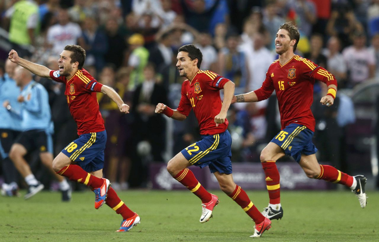 Spain's (L-R) Jordi Alba, Jesus Navas and Sergio Ramos celebrate after defeating Portugal in their Euro 2012 semi-final soccer match at the Donbass Arena in Donetsk, June 27, 2012. REUTERS/Eddie Keogh (UKRAINE - Tags: SPORT SOCCER)