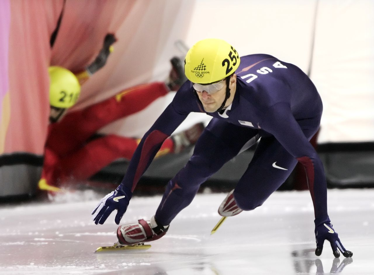 United States' Rusty Smith (255) maintains his balance while China's Li Ye, left, falls during the men's 1000 meter semi-finals at the Short Track Speed Skating competition at the Turin 2006 Winter Olympic Games in Turin, Italy, Saturday, Feb. 18, 2006. (AP Photo/Amy Sancetta)
