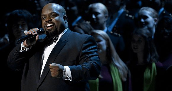 "Caption: Cee Lo Green sings during a taping of ""Christmas in Washington,"" at the National Building Museum in Washington, DC, December 11, 2011. The show, hosted by Conan O'Brien and attended by US President Barack Obama, First Lady Michelle Obama and their family, features performances and appearances by Justin Bieber, Cee Lo Green, Jennifer Hudson, Victoria Justice and The Band Perry and airs on television December 16. AFP PHOTO / Saul LOEB"
