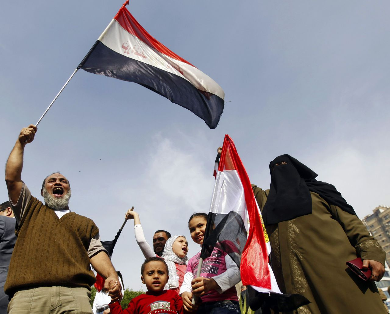 Supporter of Egyptian President Mohamed Mursi with his family chant pro-Mursi slogans, during a rally in the vicinity of Cairo University and Nahdet Misr Square in Giza, on the outskirts of Cairo December 1, 2012. Tens of thousands of Islamists demonstrated in Cairo on Saturday in support of President Mohamed Mursi, who is racing through a constitution to try to defuse opposition fury over his newly expanded powers. REUTERS/Amr Abdallah Dalsh (EGYPT - Tags: POLITICS CIVIL UNREST TPX IMAGES OF THE DAY)