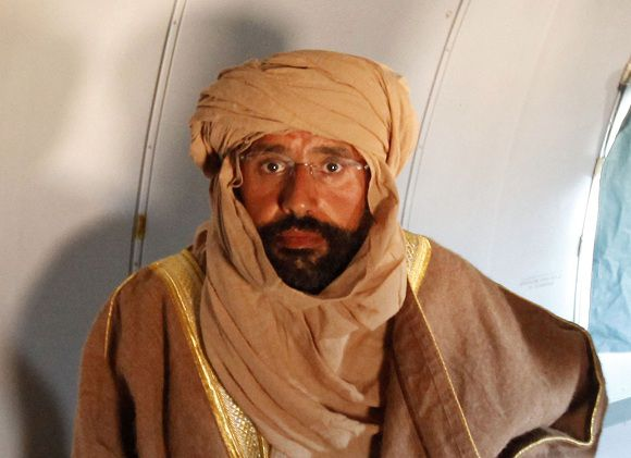 Saif al-Islam Gaddafi is seen sitting in a plane in Zintan November 19, 2011. Saif al-Islam Gaddafi told Reuters on Saturday that he was feeling fine after being captured by some of the fighters who overthrew his father and he said injuries to his right hand were suffered during a NATO air strike a month ago. REUTERS/Ismail Zitouny (LIBYA - Tags: POLITICS CIVIL UNREST)