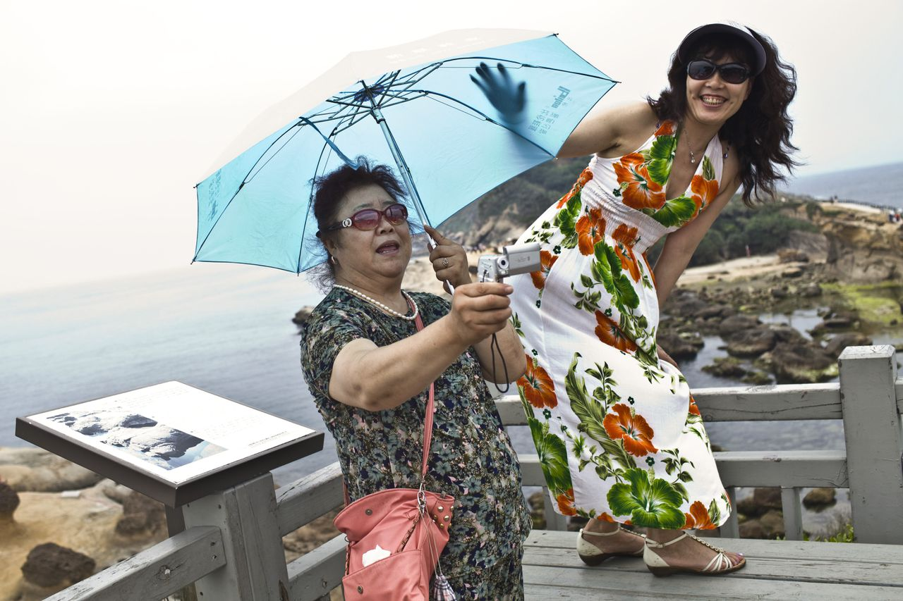 Chinese tourists visit Yehliu Geopark, in Taipei, Taiwan, June 10, 2011. Relations have warmed between the Republic of China and the People's Republic of China, as they are formally known, since Taiwan's 2008 election of President Ma Ying-jeou, and an agreement to open the door to group tours from the mainland. (Shiho Fukada/The New York Times)