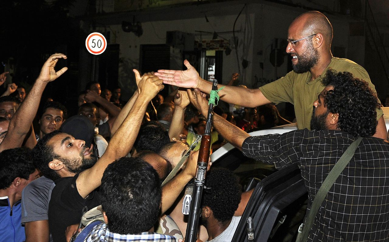 Saif Al-Islam, son of Muammar Gaddafi, greets supporters in Tripoli August 23, 2011. Saif told journalists that Libya, which has been largely overrun in the past 24 hours by rebel forces seeking to topple his father, was in fact in government hands and that Muammar Gaddafi was safe. REUTERS/Paul Hackett (LIBYA - Tags: POLITICS CIVIL UNREST)
