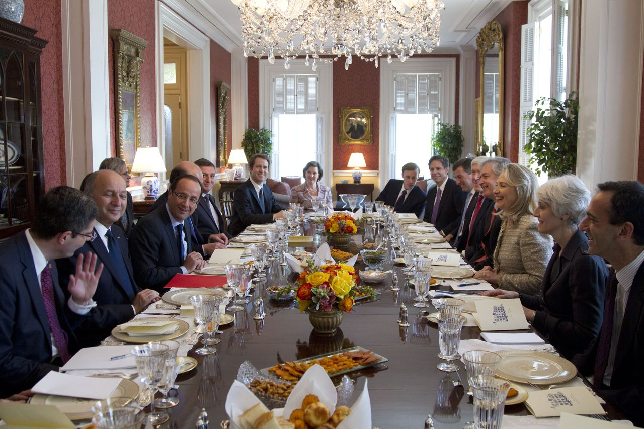 Secretary of State Hillary Rodham Clinton, third from right, hosts a working lunch for French President Francois Hollande, third from left, at the Blair House., Friday, May 18, 2012, in Washington. (AP Photo/Carolyn Kaster)