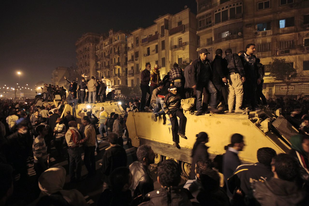 Anti-government protesters surround and stand atop an Egyptian army armoured personnel carrier, near the Tahrir Square, in downtown Cairo, Egypt, Friday, Jan. 28, 2011. Egyptian activists protested for a fourth day as social networking sites called for a mass rally in the capital Cairo after Friday prayers, keeping up the momentum of the country's largest anti-government protests in years. (AP Photo/Lefteris Pitarakis)