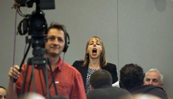 Medea Benjamin tijdens de speech van Obama.