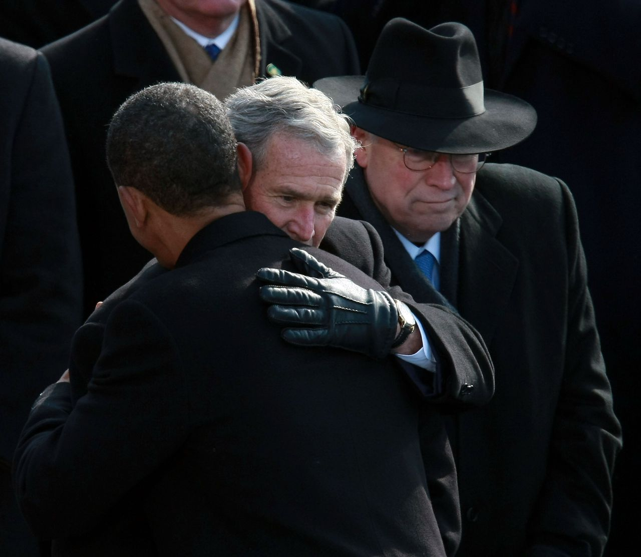 WASHINGTON - JANUARY 20: President Barack Obama shakes hugs president George W. Bush as vice-president Dick Cheney looks on during Obama's inauguration as the 44th President of the United States of America on the West Front of the Capitol January 20, 2009 in Washington, DC. Obama becomes the first African-American to be elected to the office of President in the history of the United States. Justin Sullivan/Getty Images/AFP == FOR NEWSPAPERS, INTERNET, TELCOS & TELEVISION USE ONLY ==