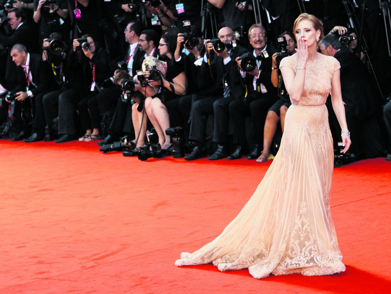 U.S. Actress Jessica Chastain arrives on the red carpet for the premiere of the film Wilde Salome at the 68th edition of the Venice Film Festival in Venice, Italy, Sunday, Sept. 4, 2011. (AP Photo/Joel Ryan)