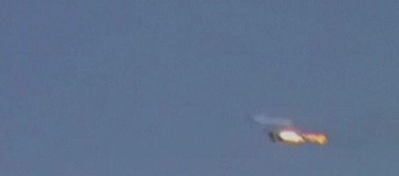 """A fighter jet is engulfed in flames in this still picture taken from amateur video said to be shot on August 13, 2012. The video showed a fighter jet engulfed in flames in the sky in an episode described in the video as rebels shooting down a Syrian army fighter jet over the town of Mohassen, in Deir al-Zor province in Syria. A Syrian fighter jet crashed in eastern Syria on Monday, state television said, hours after rebels said they had brought down a jet in the same area. The official news channel Syria TV said the plane crashed due to technical problems during a """"regular training mission"""". REUTERS/Social Media via REUTERS TV (SYRIA - Tags: CONFLICT MILITARY) FOR EDITORIAL USE ONLY. NOT FOR SALE FOR MARKETING OR ADVERTISING CAMPAIGNS. THIS IMAGE HAS BEEN SUPPLIED BY A THIRD PARTY. IT IS DISTRIBUTED, EXACTLY AS RECEIVED BY REUTERS, AS A SERVICE TO CLIENTS"""