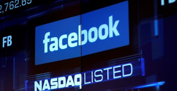 Caption: Monitors show the value of the Facebook, Inc. stock during morning trading at the NASDAQ Marketsite in New York in this file photo taken June 4, 2012. REUTERS/Eric Thayer/Files (UNITED STATES - Tags: BUSINESS)