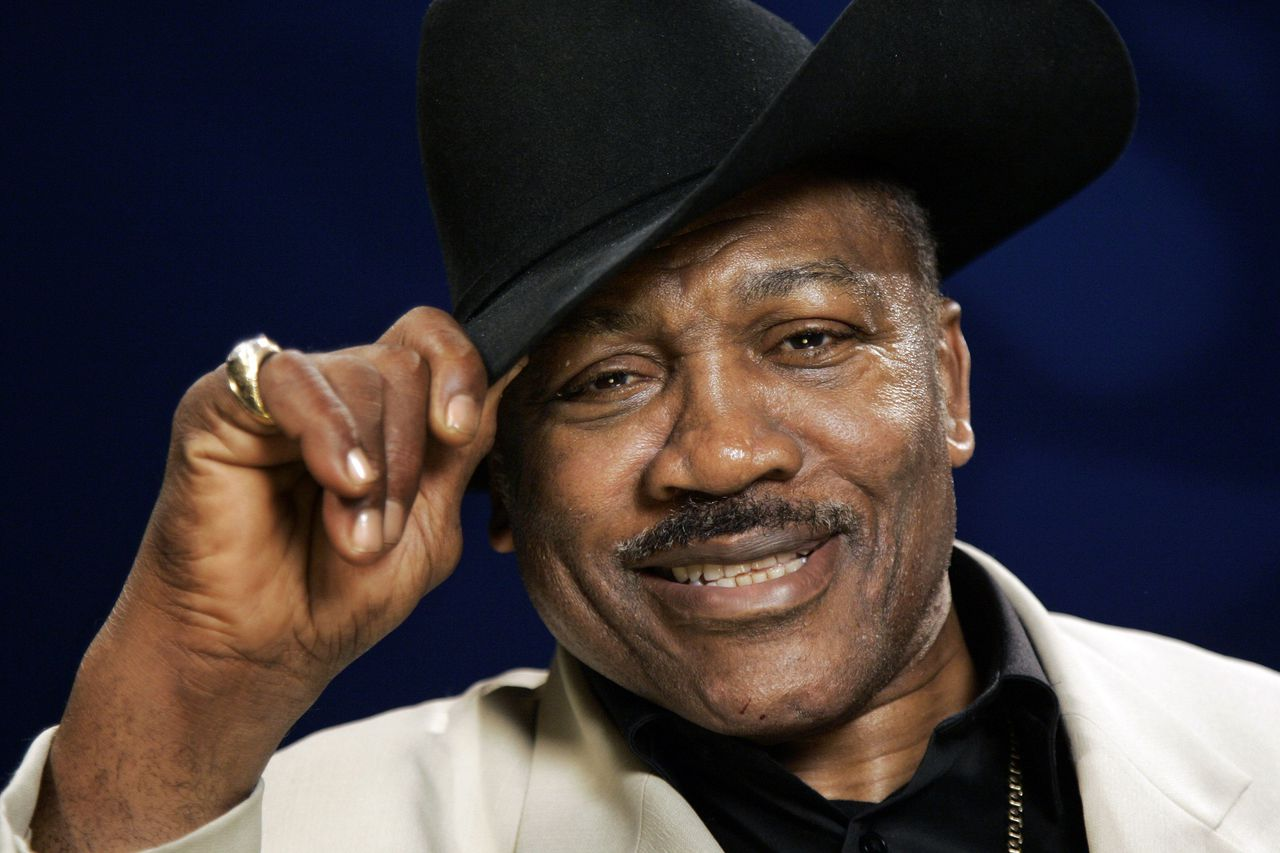 FILE - In this April 2, 2009 file photo, Boxing legend Joe Frazier poses for a portrait in New York. (AP Photo/Jeff Christensen, File)