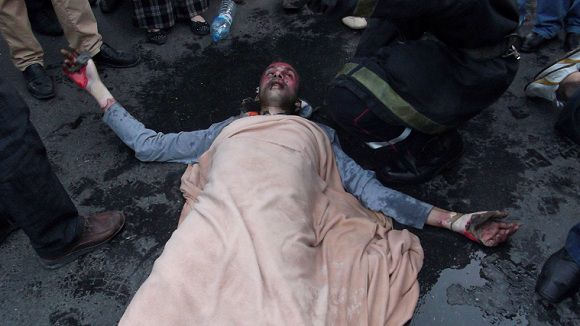 """Caption: In this photo provided by a Moroccan media group called """"the Unemployed Graduates"""" and dated Wednesday, Jan. 18, 2012, a Moroccan protester lies on ground covered with a blanket after setting himself on fire in a demonstration over unemployment in Rabat, Morocco. Five unemployed Moroccan men set themselves on fire in the capital Rabat as part of widespread demonstrations in the country over the lack of jobs, especially for university graduates, a rights activist said Thursday, and three of them were hospitalized because of their burns. The self immolation echoes the 2010 protest when a vegetable seller in Tunisia set himself on fire, an act which sparked the Arab spring. (AP Photo/Media Group Unemployed Graduates)"""