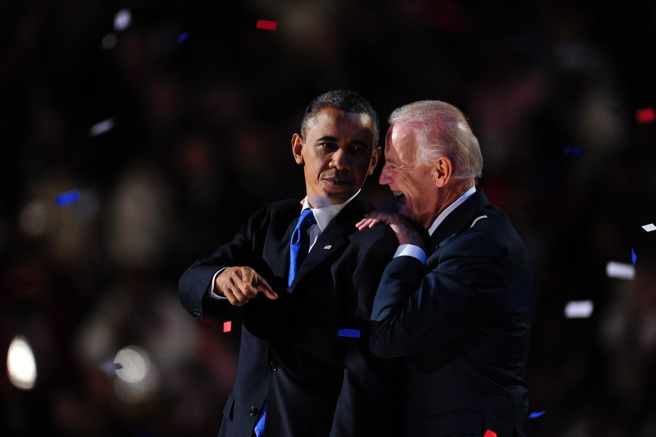 US President Barack Obama and Vice President Joe Biden celebrate on stage after Obama delivered his acceptance speech on November 7, 2012 in Chicago. Obama swept to re-election, forging history again by transcending a slow economic recovery and the high unemployment which haunted his first term to beat Republican Mitt Romney. AFP PHOTO / Robyn Beck