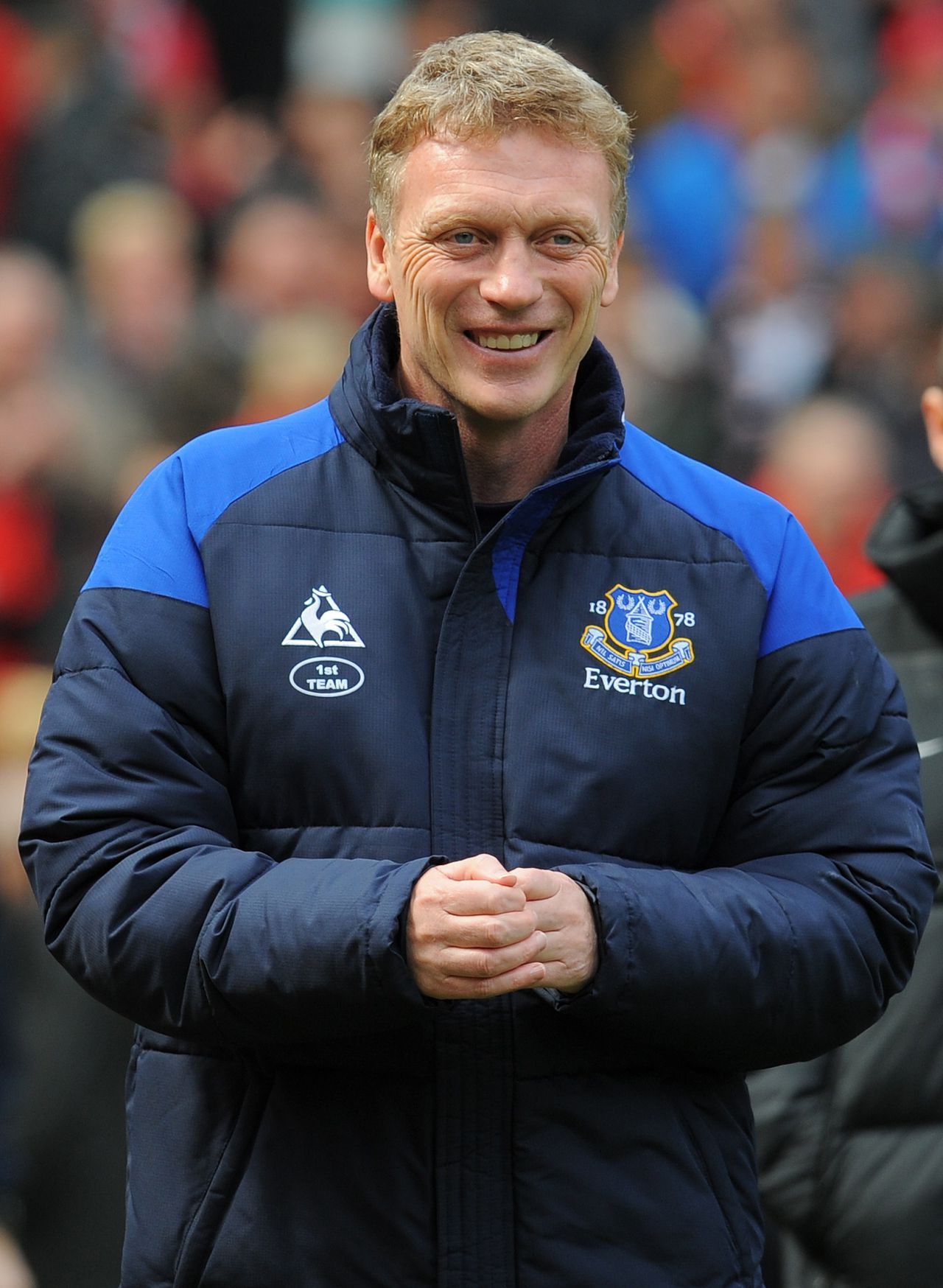 """(FILES) In a file picture taken on April 22 2012 Everton's Scottish manager David Moyes takes his seat before the English Premier League football match between Manchester United and Everton at Old Trafford in Manchester, north-west England. Everton confirmed on on May 9, 2013 that manager David Moyes will leave the club at the end of the season, paving the way for him to succeed Alex Ferguson at Manchester United. AFP PHOTO/ANDREW YATES RESTRICTED TO EDITORIAL USE. No use with unauthorized audio, video, data, fixture lists, club/league logos or """"live"""" services. Online in-match use limited to 45 images, no video emulation. No use in betting, games or single club/league/player publications."""