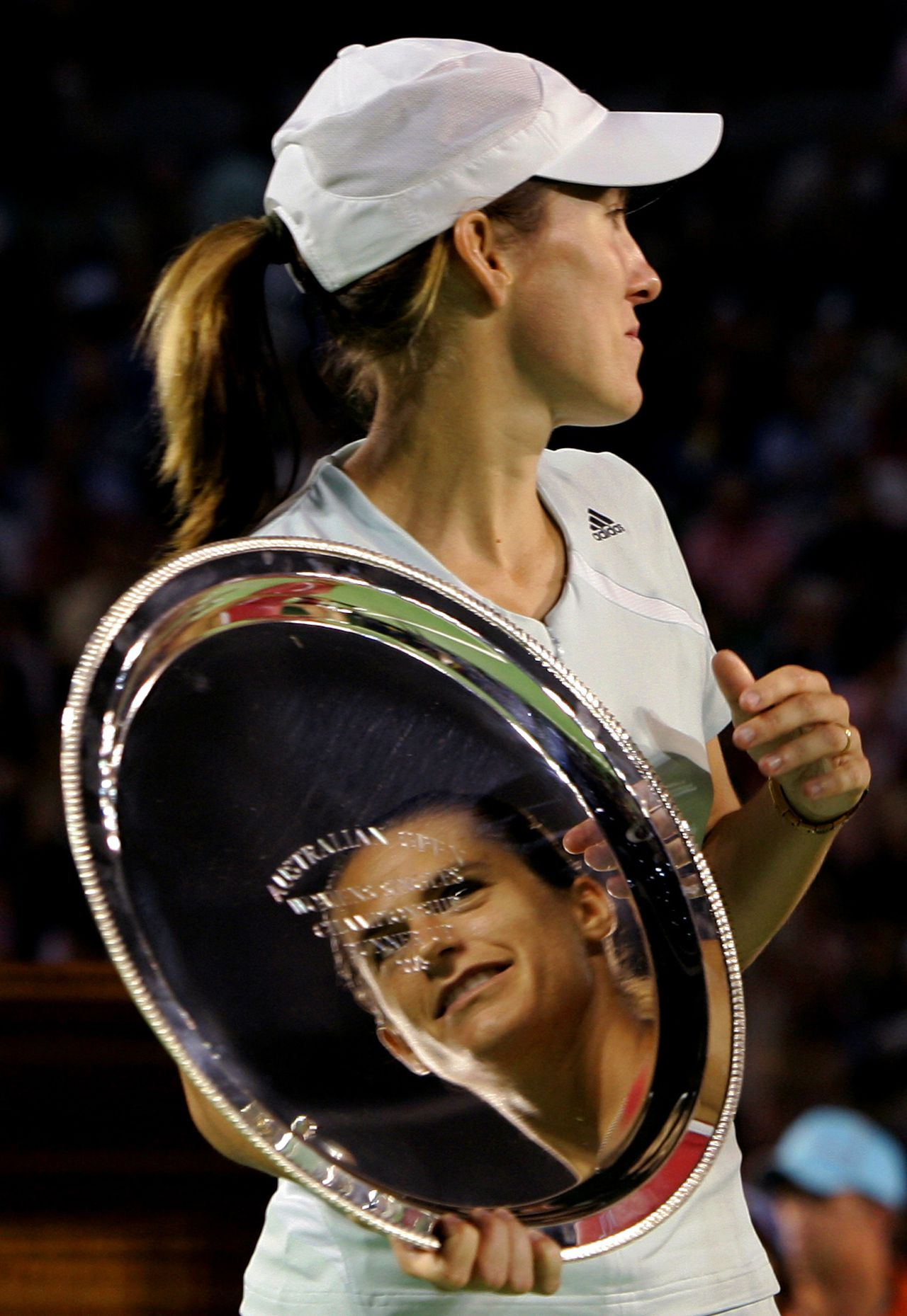 PICTURES OF THE YEAR 2006 Amelie Mauresmo of France is reflected in the runner-up trophy held by Justine Henin-Hardenne of Belgium after the women's singles final at the Australian Open tennis tournament in Melbourne January 28, 2006. REUTERS/David Gray