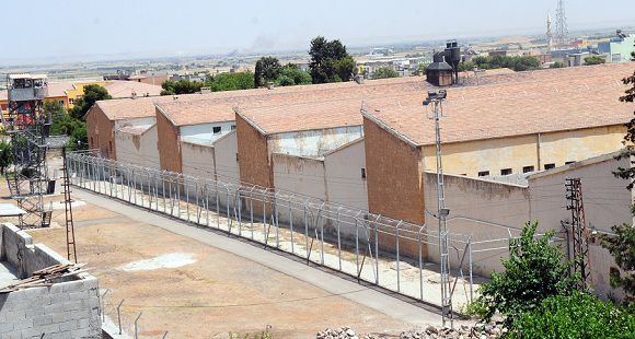 "Caption: Sanliurfa city prison is pictured on June 17, 2012, in Sanliurfa. At least 13 prisoners died from smoke inhalation after inmates started a fire during a mutiny in a jail in southeastern Turkey, officials said Sunday. The prisoners set fire to blankets and beds in a cell in the Sanliurfa city prison late Saturday, but it was brought under control before it could spread throughout the jail, which holds 1,000 inmates, the Anatolia news agency reported, quoting governor Celalettin Guvenic. Another five inmates in the cell were hospitalised, it said. The fire broke out during a fight between inmates, Turkey's Prime Minister Recep Tayyip Erdogan told Anatolia, relaying a survivor's account. ""I was also informed by the governor that the conditions in the cell were not suitable to accommodate that many inmates,"" he added. Sanliurfa, the city's largest jail, reportedly has a capacity of around 250. AFP PHOTO/STR"