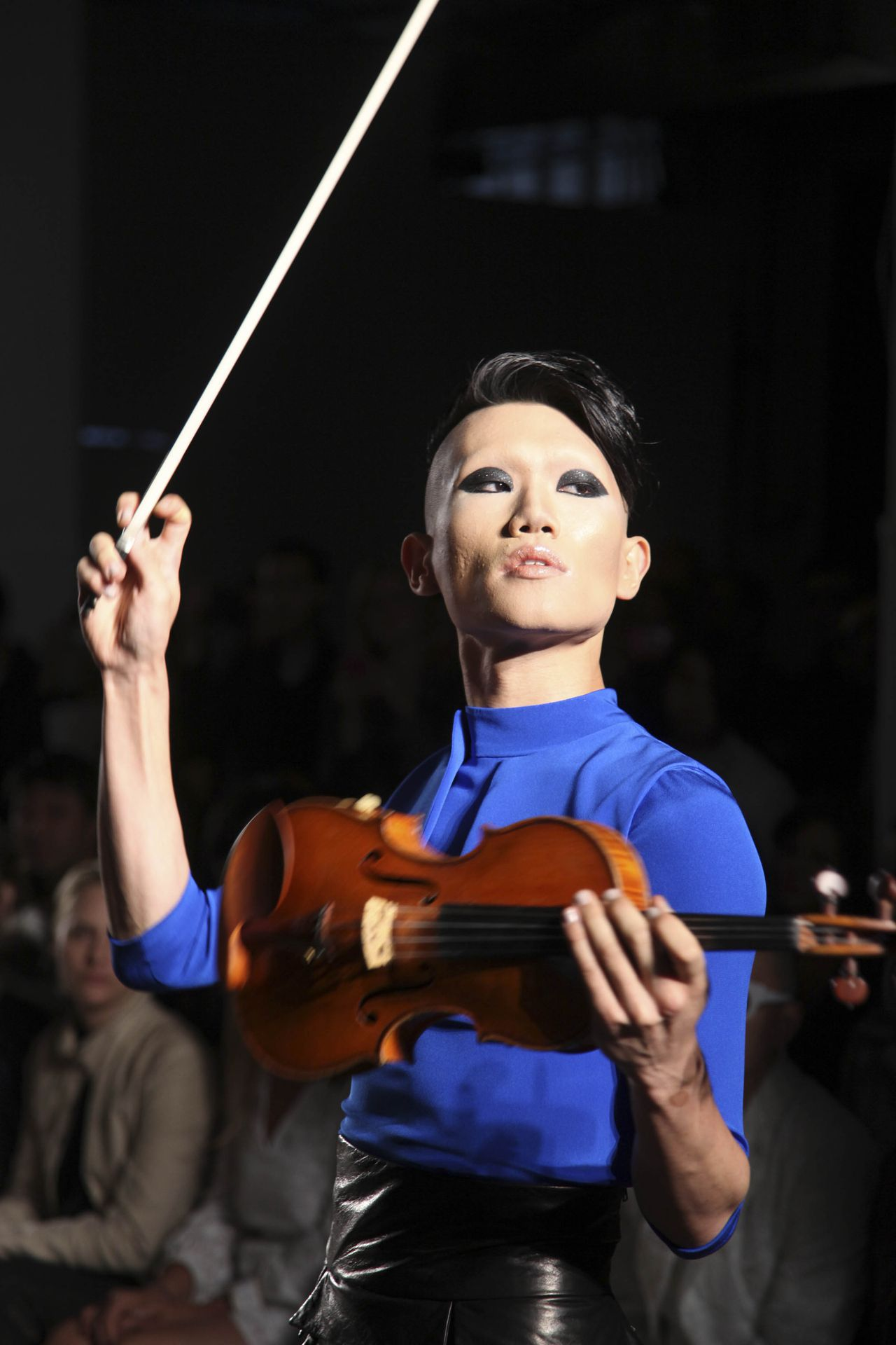 This Sunday, Sept. 12, 2010 photo released by Will Ragozzino/PatrickMcMullan.com shows violinst Hahn-Bin performing at the presentation of the Elise Overland spring 2011 collection during Fashion Week in New York. (AP Photo/PatrickMcMullan.com, Will Ragozzino) NO SALES, EDITORIAL USE ONLY