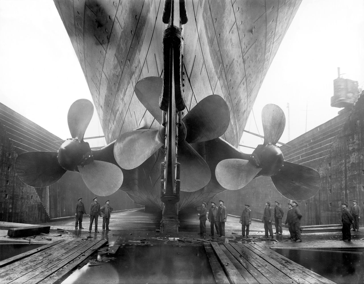 The three steam-powered propellers of the RMS Titanic in dry dock are shown in a undated photograph released to the press on Jan. 21, 2010. Built in Belfast by the Harland & Wolff shipyard, the Titanic was intended to be the largest, most luxurious and safest ship in the world. Source: Titanic: The Artifacts Exhibition via Bloomberg EDITOR'S NOTE: NO SALES. EDITORIAL USE ONLY.
