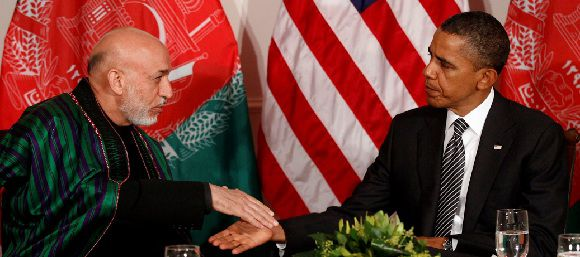 Caption: U.S. President Barack Obama (R) shakes hands with Afghanistan President Hamid Karzai in New York September 20, 2011. The head of Afghanistan's High Peace Council, former President Burhanuddin Rabbani, was killed in Kabul today. REUTERS/Kevin Lamarque (UNITED STATES)