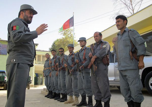 In this June 18, 2011 photo, Samiullah Qatra, left, the provincial police chief of Kunduz gives speeches to Afghan policemen in Kunduz north of Kabul, Afghanistan. Buried behind the airport in northern Afghanistan's Kunduz city, police uncovered 2,000 kilograms (4,400 pounds) of explosives, enough to make dozens of suicide vests or improvised explosive devises able to shear through armor, maiming and killing those inside, the provincial police chief told The Associated Press this week. (AP Photo/Fulad Hamdard)