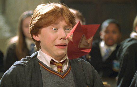 """Caption: RUPERT GRINT (Ron Weasley) in Warner Bros. Pictures' family adventure film Harry Potter and the Chamber of Secrets (2002) Ronald """"Ron"""" Virus Wemel"""