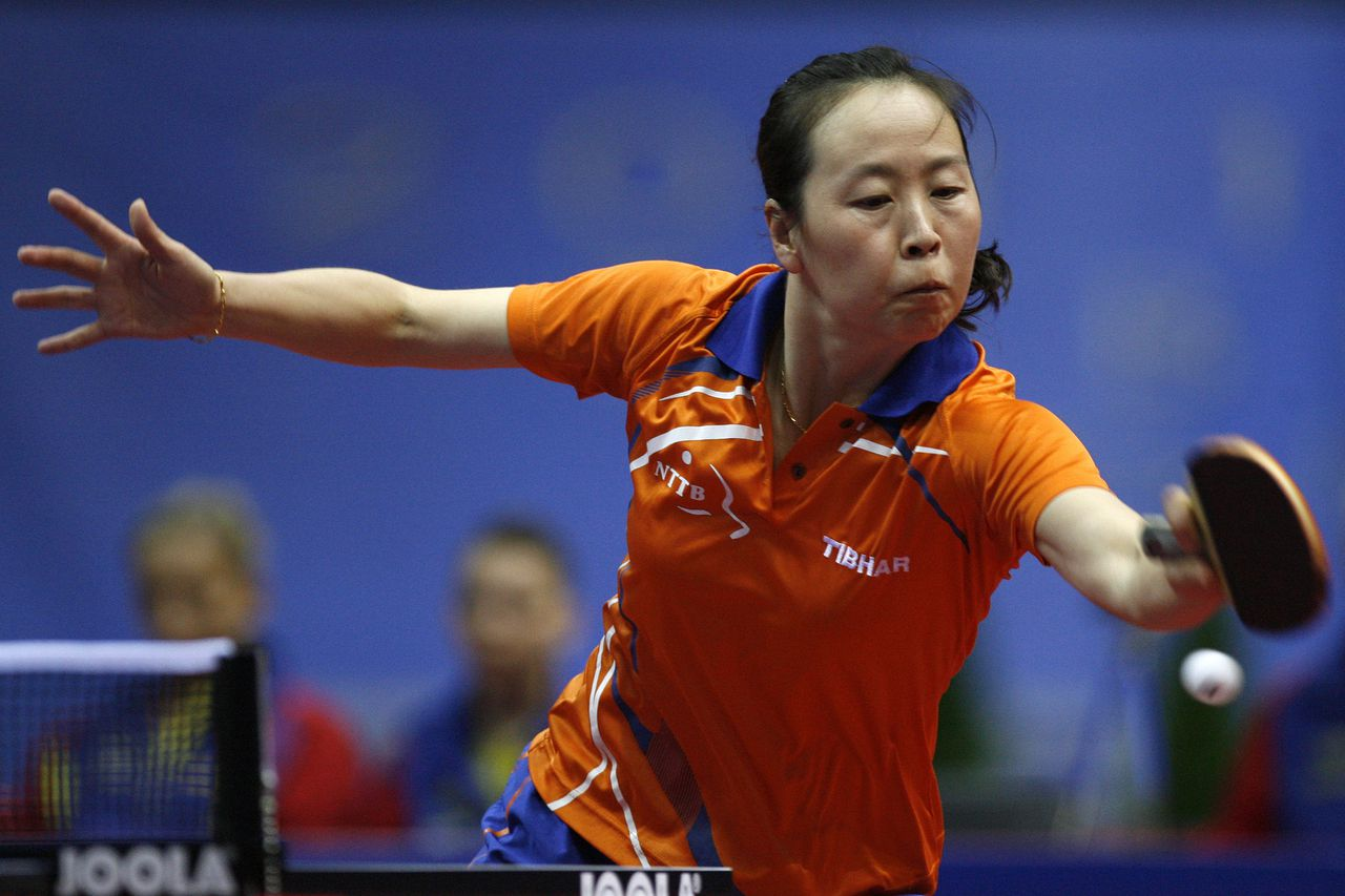 Li Jiao from The Netherlands returns the ball to Romania's Elizabeta Samara during their Women's Team Final game at the European Table Tennis Championships, in Gdansk, Poland, Wednesday, Oct. 12, 2011. (AP Photo/Wojtek Figurski) --POLAND OUT--