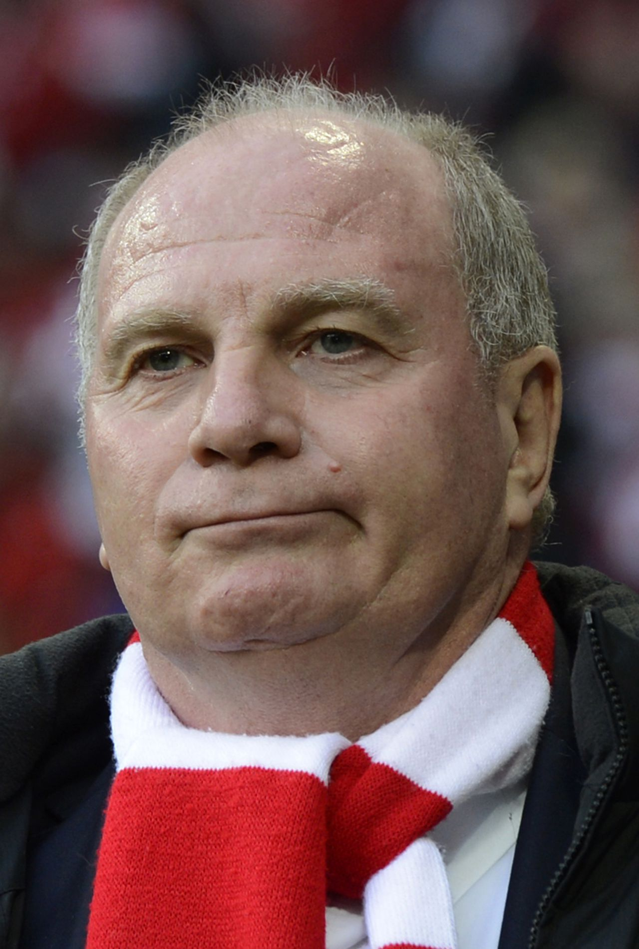 FILES - Picture taken on November 24, 2012 shows Bayern Munich's President Uli Hoeness ahead of the German first division Bundesliga football match FC Bayern Munich vs Hanover 96 in Munich, southern Germany. Hoeness has admitted in an interview with German weekly 'Die Zeit' that he is going through 'hell' as the tax evasion scandal he has become caught up in shows no signs of abating. AFP PHOTO / CHRISTOF STACHE