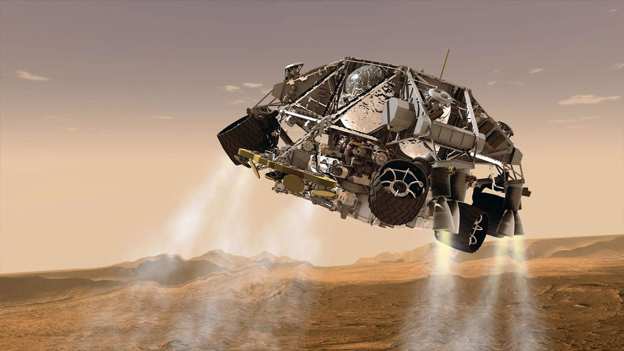 This artist's concept provided by NASA/JPL-Caltech via the Rockford Register Star, shows the rover and descent stage for NASA's Mars Science Laboratory spacecraft during the final minute before the rover, Curiosity, touched down on the surface of Mars. Dan Scharf, a senior engineer with NASA's Jet Propulson Laboratory in California was in charge of the guidance, navigation and control for the backup landing system for the Mars Science Laboratory spacecraft that carried the Curiosity rover to Mars. That backup system would have taken over steering for the spacecraft to hit its landing target, if there had been any problems with the primary landing system. Scharf was a 1991 graduate of Boylan Catholic High School in Rockford, Ill. (AP Photo/Courtesy of NASA/JPL-Caltech via the Rockford Register Star) MANDATORY CREDIT