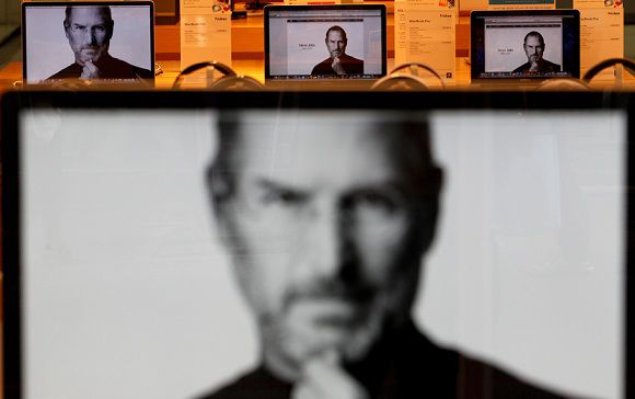 Caption: The monitors show the image of Apple co-founder Steve Jobs at an electronic shop in Seoul, South Korea, Thursday, Oct. 6, 2011. Jobs died on Wednesday at the age of 56. (AP Photo/Lee Jin-man)