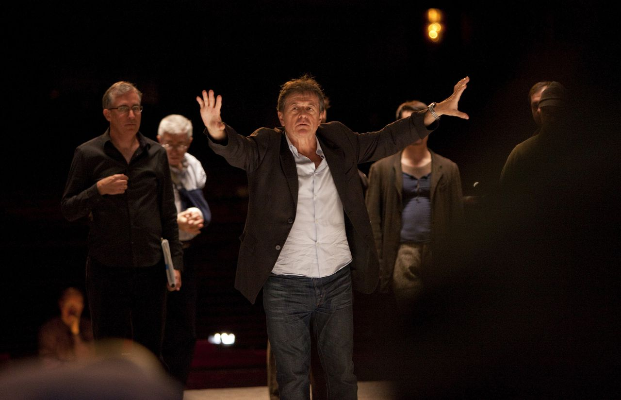 "Director Patrice Chereau, center, rehearses the opera ""From the House of the Dead"" by Leos Janacek at the Metropolitan Opera in New York, U.S., on Nov. 5, 2009. It will be Chereau's Met debut, as well as for the conductor Esa-Pekka Salonen. Photographer: Ken Howard/Metropolitan Opera via Bloomberg EDITOR'S NOTE: NO SALES. EDITORIAL USE ONLY."
