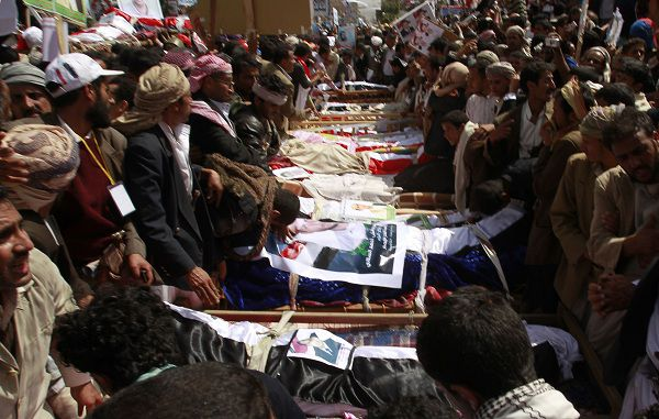 Mourners gather around the coffins of anti-government protesters during a funeral in Sanaa March 20, 2011. Mourners buried some of the 52 anti-government protesters shot dead by rooftop snipers after Muslim Friday prayers in the Arabian Peninsula state, where tens of thousands of people have protested for weeks against Yemeni President Ali Abdullah Saleh's three decades-long rule. REUTERS/Khaled Abdullah (YEMEN - Tags: POLITICS CIVIL UNREST RELIGION)