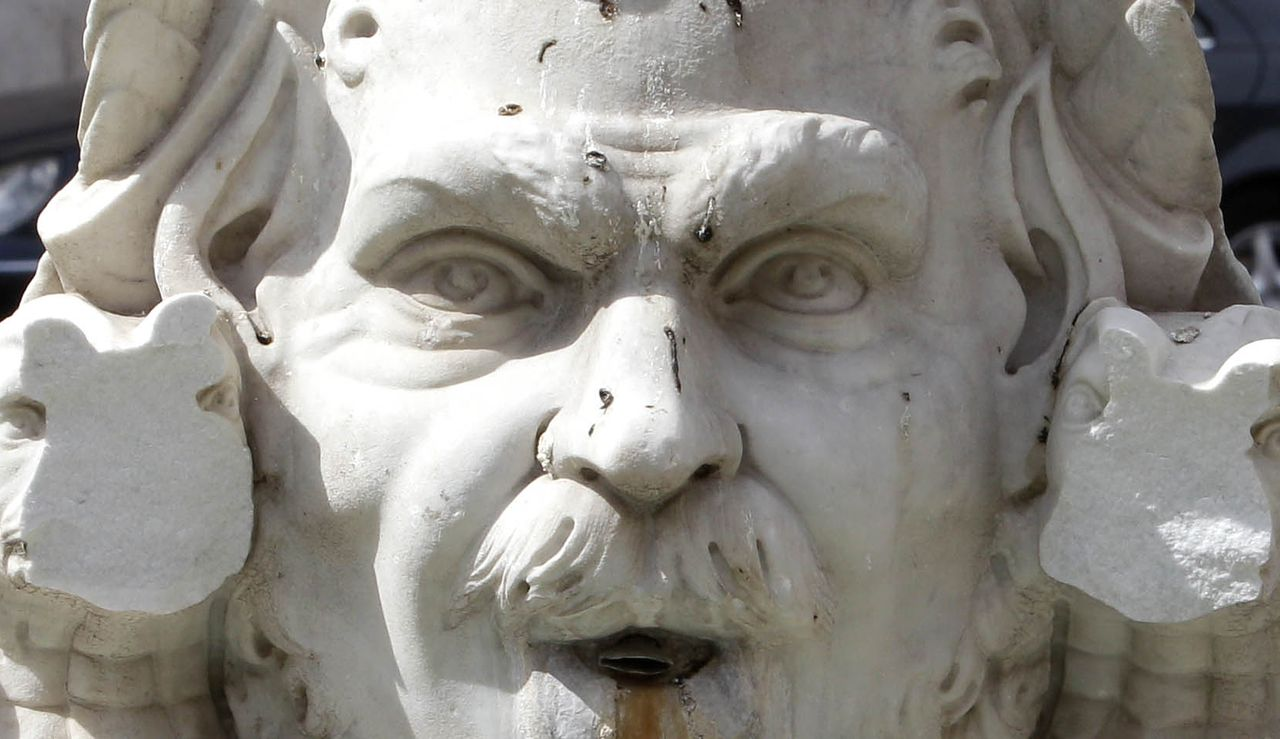 Two big chunks of marble are missing from the Moor fountain in Rome's Piazza Navona Sunday, Sept. 4, 2011. Italian police say a man has vandalized a fountain in the city's famed Piazza Navona, detaching two big chunks off a marble statue. The damaged statue was a 19th-century copy. A Rome culture official, Umberto Broccoli, said the pieces were recovered and can be reattached to the Moor Fountain. The Moor Fountain by 16th-century artist Giacomo della Porta is on the square's south end. Bernini added the central figure in the 1600s. (AP Photo/Pier Paolo Cito)