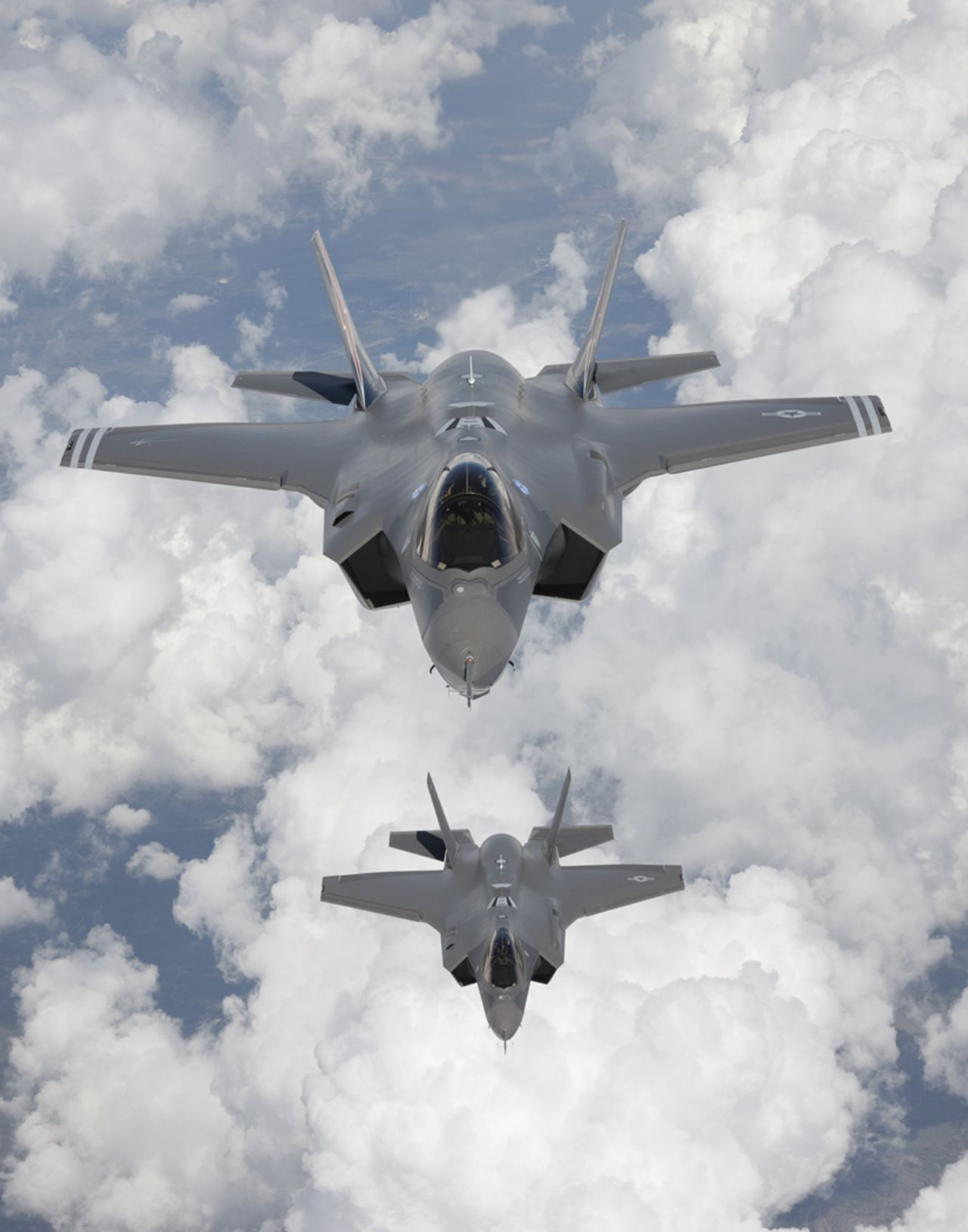 """Two F-35 Lightning II, also known as the Joint Strike Fighter (JSF), fighter aircraft are seen as they arrive at Edwards Air Force Base in California in this May 2010 file photograph. The Pentagon on September 22, 2010 said it reached a """"fixed-price"""" agreement with Lockheed Martin Corp for a fourth batch of F-35 fighter jets, wrapping up months of negotiations. REUTERS/Tom Reynolds/Lockheed Martin Corp/Handout (UNITED STATES - Tags: MILITARY BUSINESS) FOR EDITORIAL USE ONLY. NOT FOR SALE FOR MARKETING OR ADVERTISING CAMPAIGNS. THIS IMAGE HAS BEEN SUPPLIED BY A THIRD PARTY. IT IS DISTRIBUTED, EXACTLY AS RECEIVED BY REUTERS, AS A SERVICE TO CLIENTS"""
