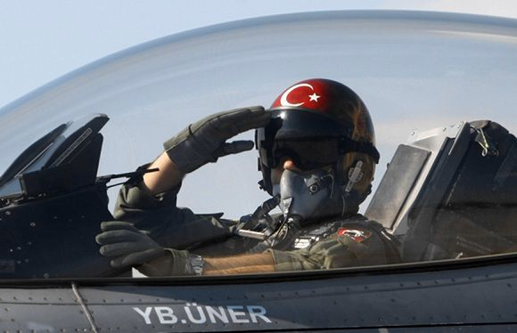 """Caption: FILE - In this April 29, 2010 file photo, a Turkish pilot salutes before take-off at an air base in Konya, Turkey. Turkish President Abdullah Gul said Saturday June 23, 2012, his country would take """"necessary"""" action against Syria for the downing of a Turkish military jet, but suggested that the aircraft may have unintentionally violated the Syrian airspace. The plane went down in the Mediterranean Sea about 8 miles (13 kilometers) away from the Syrian town of Latakia, Turkey said. (AP Photo/File)"""