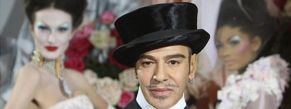 In this Jan. 25, 2010 file photo, fashion designer John Galliano poses at the end of the presentation of the Dior Haute Couture spring/summer 2010 fashion collection in Paris. Christian Dior said Tuesday, March 1, 2011, that Galliano has been immediately laid off, just days after he was suspended as its creative director pending an investigation into an alleged anti-Semitic incident in a Paris cafe last week.(AP Photo/Jacques Brinon)