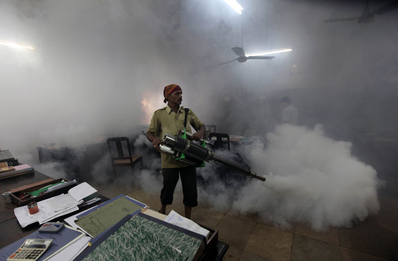 A municipal worker fumigates a factory office in Mumbai, India, Tuesday, July 6, 2010. With the onset of monsoon, several cases of Malaria have been reported in the city hospitals, local news reports said. (AP Photo/Rajanish Kakade)